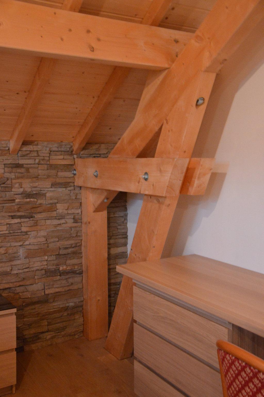 Charpente apparente, mise en valeur par le Sarking (isolation en toiture)