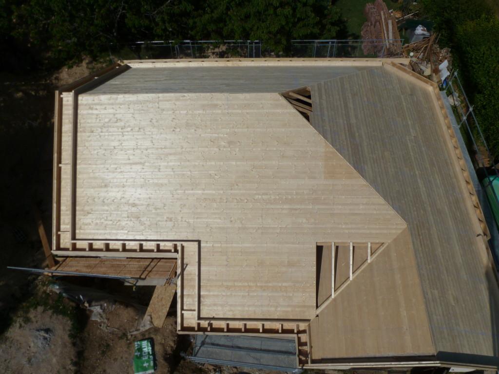 Maison ossature bois en agrandissement d'une construction existante.