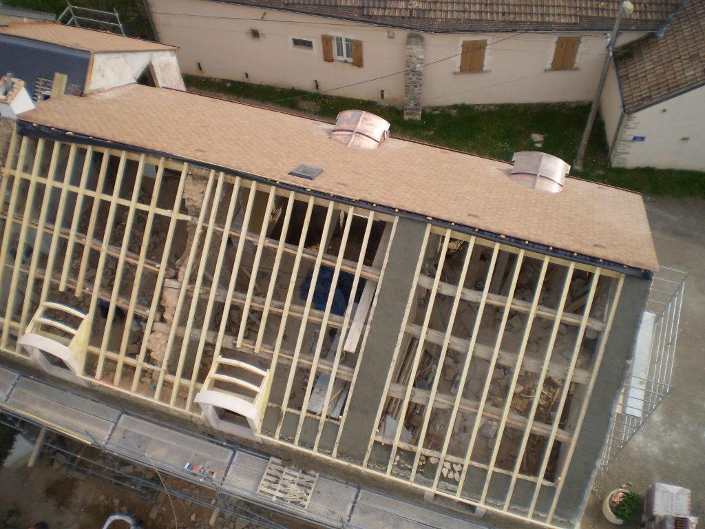 Restauration charpente avec lucarnes cintrées, redressage de toiture